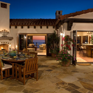 Tuscan patio photo in Orange County with a fire pit