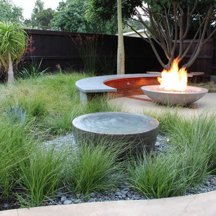 Example of a mid-sized minimalist backyard concrete patio fountain design in San Luis Obispo with no cover