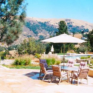 Patio - large mediterranean backyard stone patio idea in San Francisco