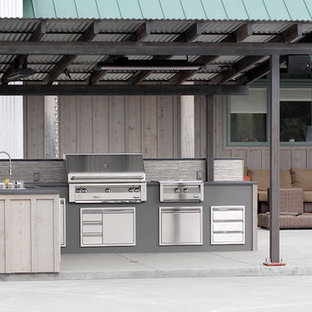 Example of a mid-sized trendy backyard concrete patio kitchen design in San Francisco with a pergola