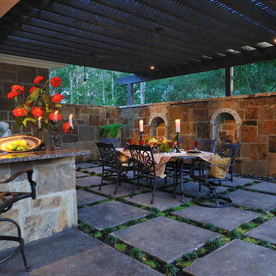 Inspiration for a large timeless side yard concrete paver patio remodel in Houston with a pergola