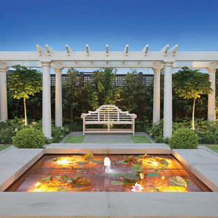 Example of a mid-sized classic patio fountain design in Melbourne with a gazebo
