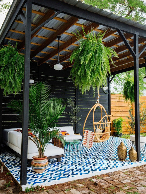 example of an eclectic tile patio design in atlanta with a gazebo - Patio Designs