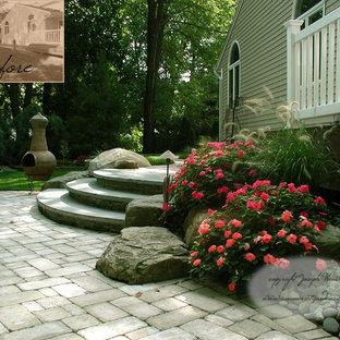 Esempio di un patio o portico boho chic