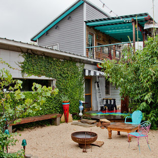 Inspiration for an eclectic patio remodel in Austin with a fire pit