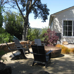 Example of a mid-sized classic decomposed granite patio design in San Francisco with a fire pit