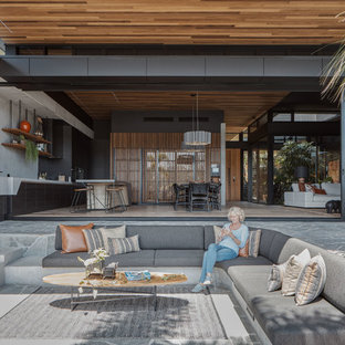Inspiration for a contemporary backyard patio in Sydney with tile and a roof extension.