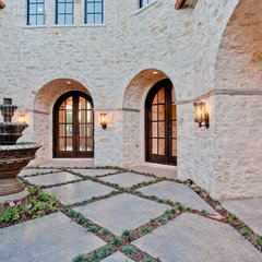 mediterranean exterior by Calais Custom Homes