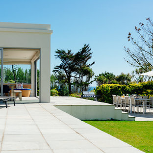 Design ideas for a nautical back patio in Cornwall with concrete paving and no cover.