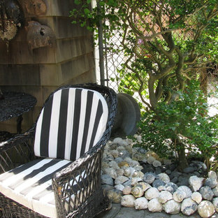 Inspiration for a small timeless backyard concrete paver patio container garden remodel in New York with a roof extension