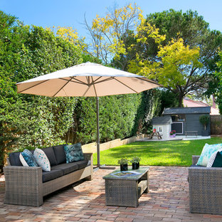 Inspiration for a transitional backyard patio in Sydney with brick pavers.