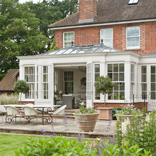 Elegant Georgian orangery with separate side entrance adjoining the home.