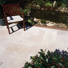 Traditional Patio by Elegant Tile and Stone