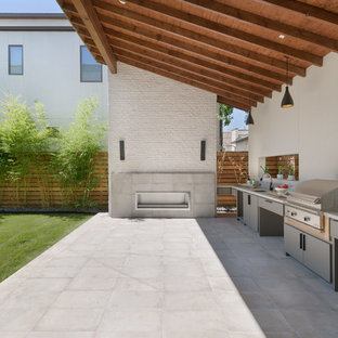 Inspiration for a contemporary backyard concrete paver patio kitchen remodel in Houston