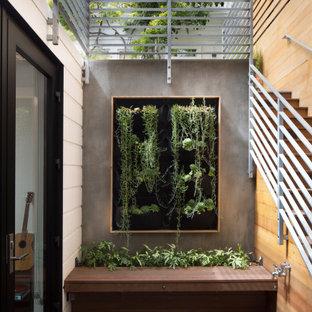 Foto di un patio o portico bohémian in cortile con pavimentazioni in pietra naturale