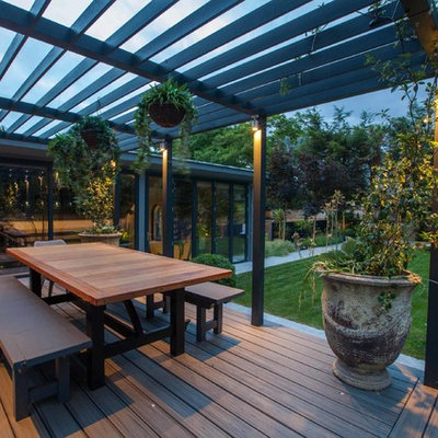 Mid-sized trendy backyard patio photo in Hampshire with decking and a pergola