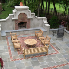 Mediterranean Patio by Bruce Clodfelter and Associates