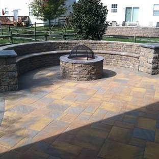 Inspiration for a mid-sized rustic backyard concrete paver patio remodel in Wilmington with a fire pit