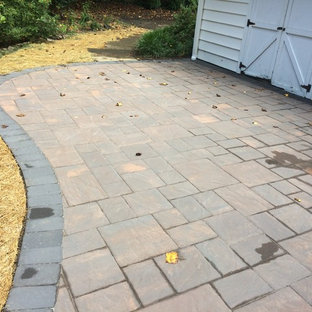 Patio - small rustic backyard concrete paver patio idea in Wilmington with a fire pit