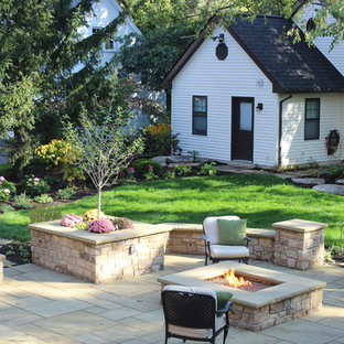 Patio - traditional backyard stone patio idea in Cleveland with a fire pit and no cover