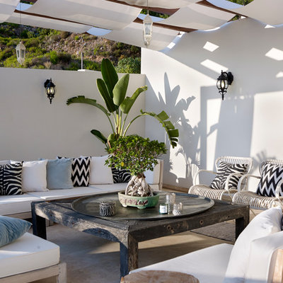 Inspiration for a mediterranean patio remodel in Other with a pergola