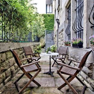 Mittelgroßer, Unbedeckter Klassischer Patio hinter dem Haus in Sonstige