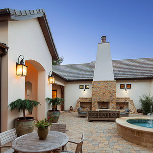 Inspiration for a mediterranean courtyard patio in Austin with a fire feature.