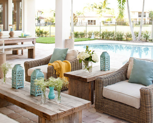 Large Transitional Backyard Brick Patio Idea In Miami With A Roof Extension
