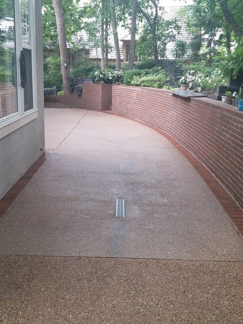 Exposed Aggregate Patio With Brick Border.
