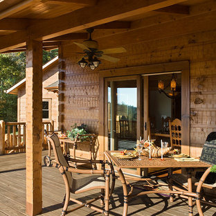 Inspiration for a mid-sized transitional backyard patio remodel in Other with decking and a roof extension