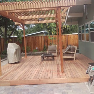 Medium sized traditional back patio in San Francisco with brick paving and an awning.