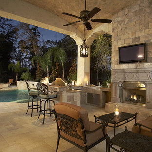 Design ideas for a mediterranean patio in Houston with an outdoor kitchen and tiled flooring.