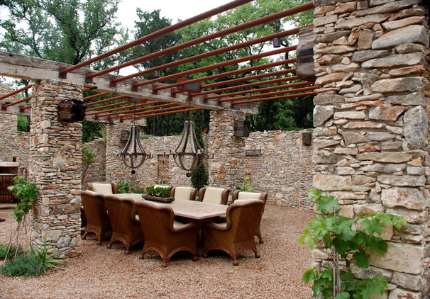 Rustic Patio by Streamline Home Staging & Redesign