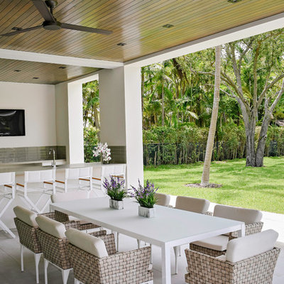 Patio kitchen - contemporary backyard tile patio kitchen idea in Miami with a roof extension