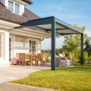 Classic back patio in Sussex with a pergola.