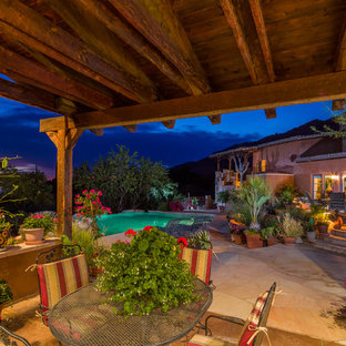 Inspiration for a southwestern backyard tile patio container garden remodel in Phoenix with a gazebo