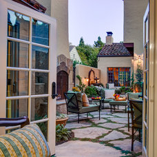 Mediterranean Patio by Harrell Remodeling