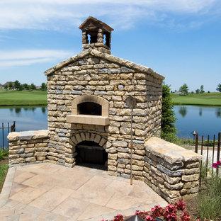 Patio kitchen - mid-sized southwestern backyard stone patio kitchen idea in Other