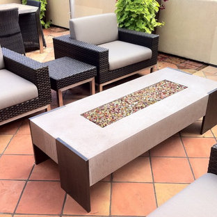 Inspiration for a mid-sized contemporary backyard tile patio remodel in San Francisco with a fire pit