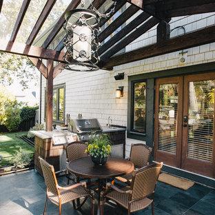 Patio - traditional patio idea in Vancouver with a pergola