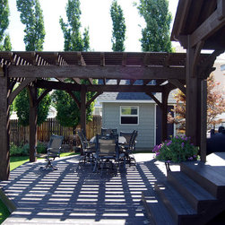 Custom Pergola Arbor Kits - This is a custom timber frame pergola kit and pavilion kit installed over a backyard deck.