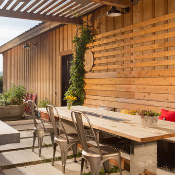 Farm style outdoor kitchen and dining area.