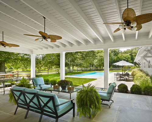 Example Of A Country Patio Design In New York With A Roof Extension