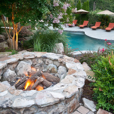 Inspiration for a large timeless backyard brick patio remodel in DC Metro with a fire pit and no cover