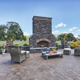 Elegant backyard patio photo in Philadelphia with a fireplace and no cover