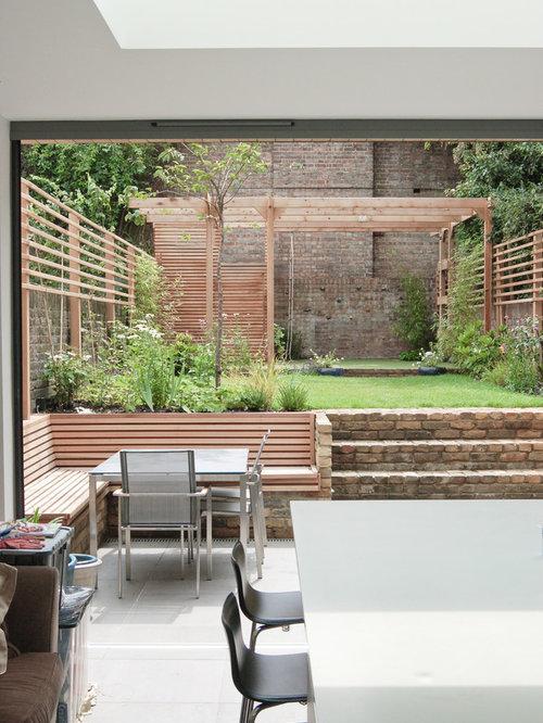 Mid Sized Contemporary Backyard Patio Idea In London