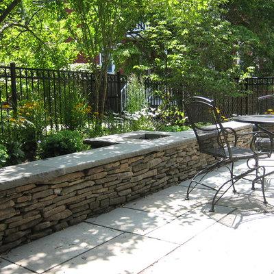 Patio - contemporary backyard stone patio idea in Boston