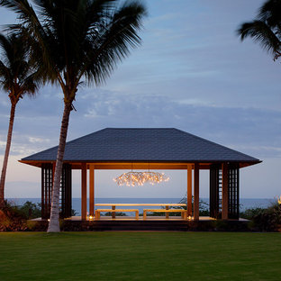 Example of an island style patio design in Hawaii with a gazebo