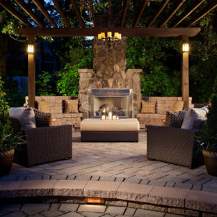 Inspiration for a large craftsman backyard brick patio remodel in Denver with a fire pit and a pergola