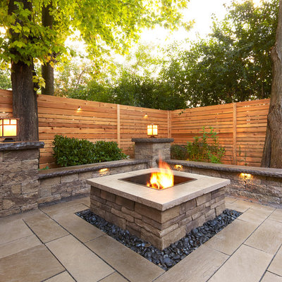 Example of a large trendy backyard stamped concrete patio design in Boston with a fire pit and no cover